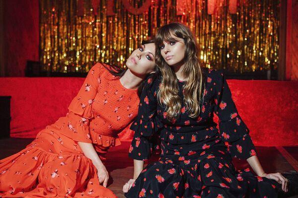 'Queens of Archive' Viv Scarlet Dress €245 & Viv Rosa Dress €245