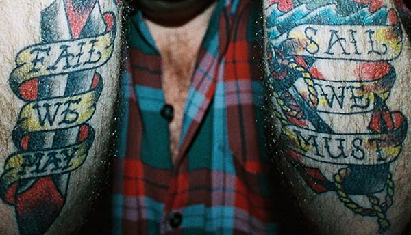 Andrew Weatherall's tattoo photographed at Good Bits in Dublin in 2010: 'Fail we may, Sail we must.' Picture: Aidan Kelly