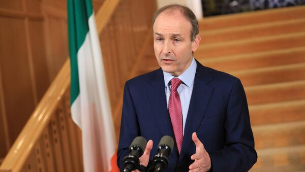 Taoiseach Micheál Martin has suggested that some restrictions on travel limits, construction, outdoor activity and sport may be eased in early April. File Picture: Julien Behal