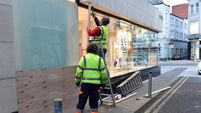 Cork businesses board up shops and heavy garda presence ahead of anti-lockdown protest