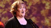 Ghost of Christmas past: Susan Boyle duets with Elvis for charity single