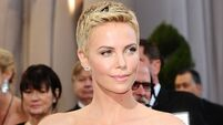 Theron 'devastated' after reshoot forces another head-shave