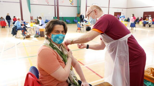 <p> First Minister Arlene Foster receiving her first Covid vaccination at Castle Park Leisure Centre in Lisnaskea, Co Fermanagh, from local GP Dr John Porteous. I</p>
