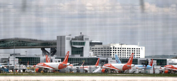 Passenger planes grounded due to the coronavirus outbreak are parked at Gatwick Airport in Sussex last year. Picture: PA