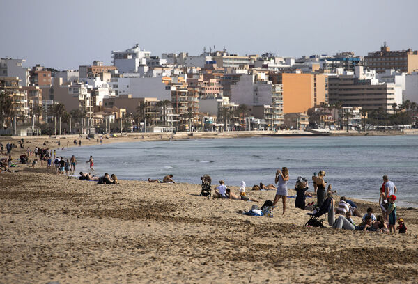 Tourists enjoy the beach at the Spanish Balearic Island of Mallorca, Spain on Monday, March 29. Picture: Francisco Ubilla/AP