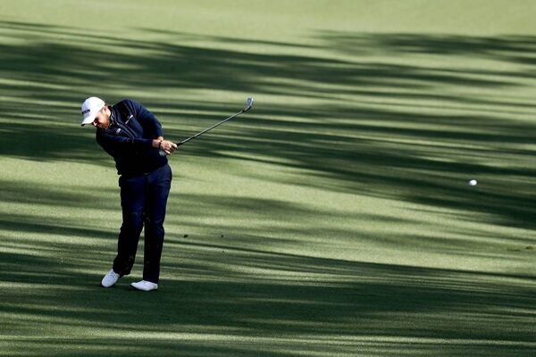 Shane Lowry plays a shot on the 13th hole at Augusta National. (Photo by Rob Carr/Getty Images)