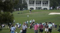 Play suspended at the Masters due to weather