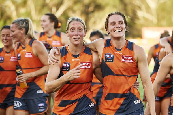 Cora Staunton and Pepa Randall of the GWS Giants celebrate victory over the West Coast Eagles. Photo by Brett Hemmings/Getty Images