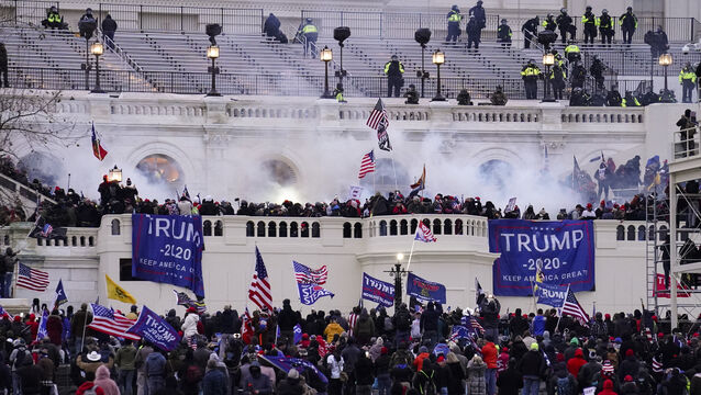 People storm the Capitol in Washington on January 6 (John Minchillo/AP)