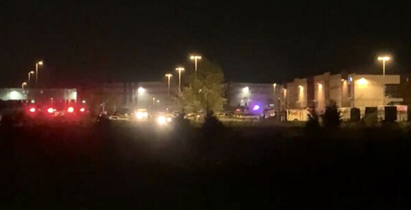This image made from video shows a wide view of building with flashing lights from emergency vehicles in Indianapolis, IN, Friday, April 16, 2021. Police in Indianapolis say multiple people were shot and killed in a shooting late Thursday at a Fedex facility. (WRTV via AP)