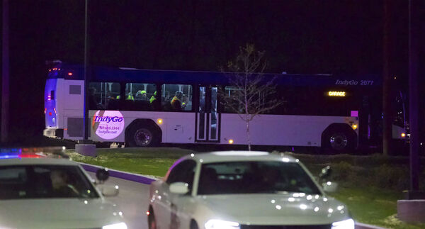 A bus transports people from the scene of a shooting at the FedEx Ground facility in Indianapolis, Thursday night, April 15, 2021. Multiple people were shot and killed in a late-night shooting at a FedEx facility in Indianapolis, and the shooter killed himself, police said.(Mykal McEldowney/The Indianapolis Star via AP)