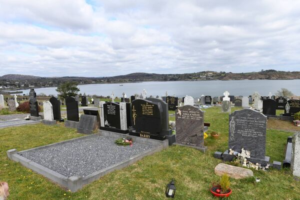 Clarissa McCarthy's grave with Schull Harbour in the background.