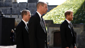 Troubled brothers William and Harry chat briefly after funeral of their grandfather