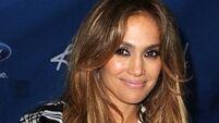 Jlo ignores the news to pretend everyone in world is happy