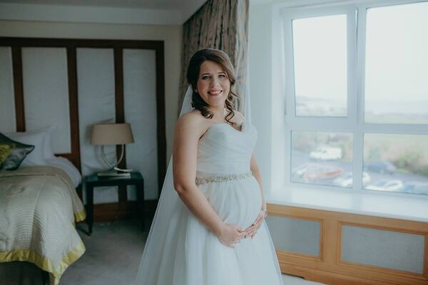 Fabulous: Linda Kelly on her 'new' wedding day — she wore a different dress from Rice 'n Rose in Douglas. Picture: Naomi Kamat Photography