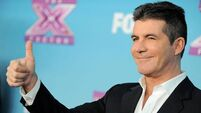 Cameras film Cowell's pad to promote online talent search