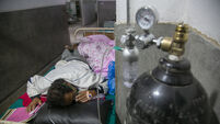 India hits another grim infections record as it scrambles to meet oxygen demands