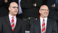 Joel and Avram Glazer file photo