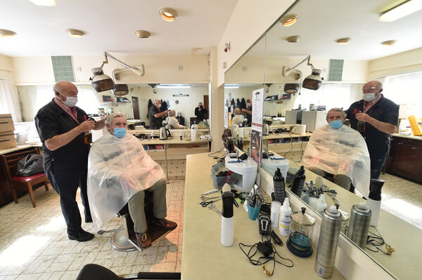 Mick Moriarty (the Baldy Barber) started his 55th year yesterday by cutting the hair of Dan Joe McCarthy at Moriarty's Barbers, Blackpool, Cork. Picture: Dan Linehan
