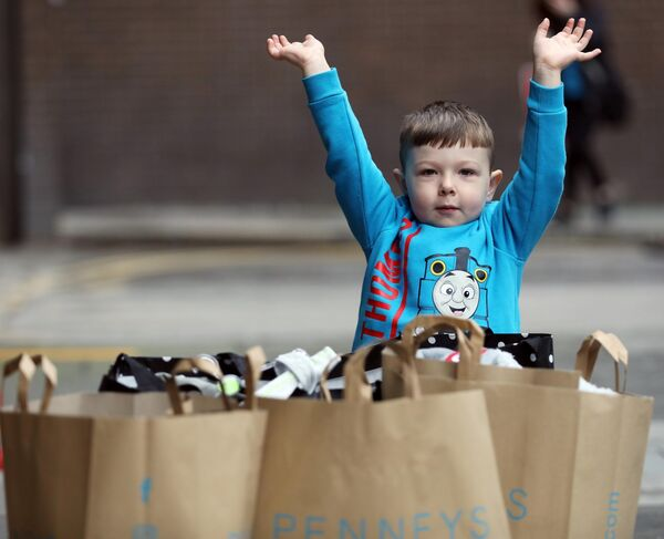 Frankie Gorman, aged 4, from Finglas with shopping bags outside Penneys on O'Connell Street Dublin on Monday. Picture: Leah Farrell/RollingNews.ie