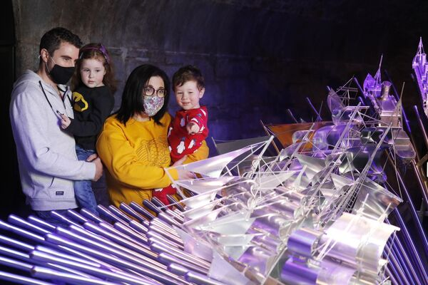 Jason and Triona Gunning with their children Caoimhe, 4, and Luke, 2, walk around the EPIC museum in CHQ Dublin. Picture: Leon Farrell/Photocall Ireland