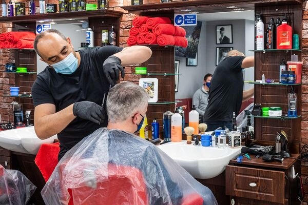 Golden Scissors Barber shop in Bandon was busy from early morning. Picture: Andy Gibson.