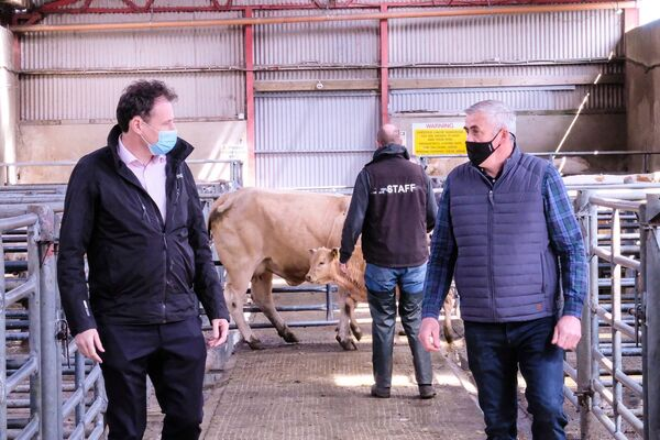 Minister for Agriculture Charlie McConalogue speaking to farmers and mart staff in Carndonagh Mart, Co Donegal.