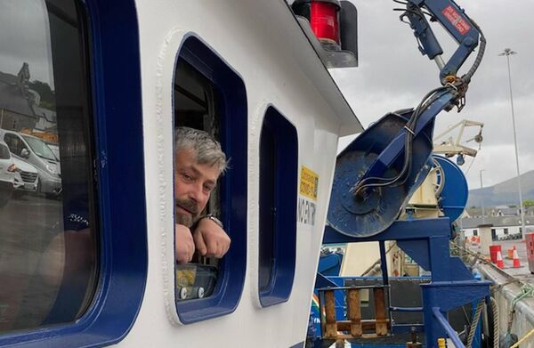 Damien Turner, the skipper of the Roise Catriona, the third of eight trawlers to leave Castletownbere in West Cork last night on their way to join dozens of other boats in Cork Harbour. Picture: Neil Michael