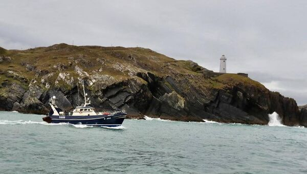 A photo taken yesterday evening from the Roise Catriona of another trawler in the West Cork flotilla making its way from Castletownbere to join up with more fishing boats in Cork Harbour. Picture: Neil Michael
