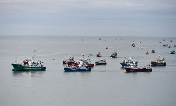 A flotilla of fishing boats approaching Roches Point Wednesday morning.  The fishermen were on their way to Taoiseach Micheál Martin's constituency offices in Turner's Cross, to deliver a letter highlighting the plight of the industry.  Photo: Larry Cummins