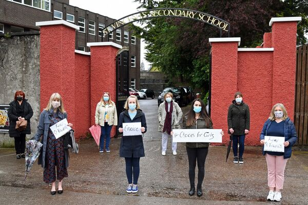 Some staff who joined parents and students at the protest outside the school.  Photo credit: Denis Minihane