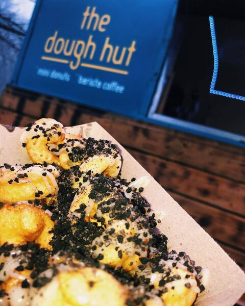 The Dough Hut top their fresh mini donuts with an array of toppings like sprinkles.
