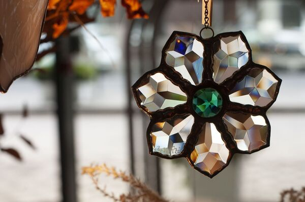 The Evie flower pendant can be hung in a window to catch the light (€75 at Biancadivito.com).