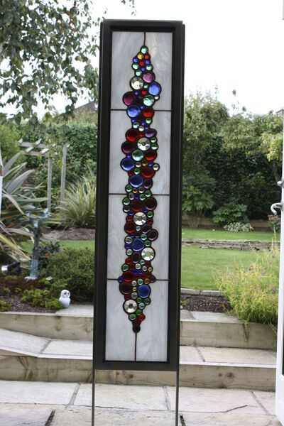 A private commission of a steel-framed stained glass outdoor piece by Bianca Divito can typically start at €2,000.