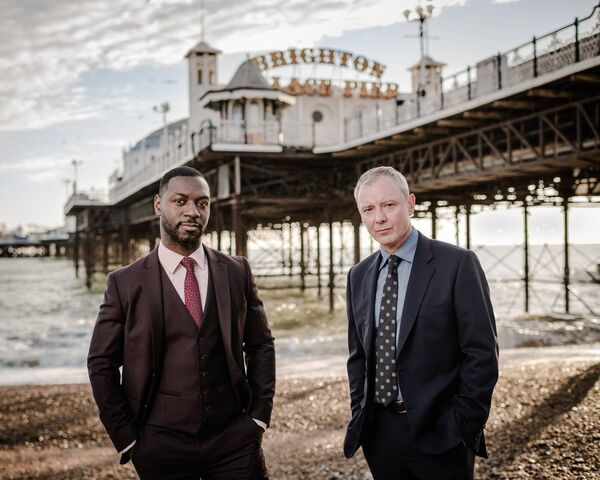 Detective Superintendent Roy Grace (John Simm) and Detective Sergeant Glenn Branson (Richie Campbell), in Grace, based on Peter James' Roy Grace series
