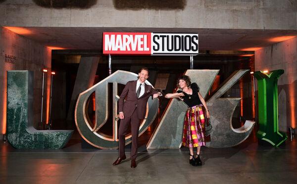 Tom Hiddleston and Sophia Di Martino attend a photocall for Disney's Loki in London. Marvel Studios' Loki, starts streaming today with new episodes Wednesdays on #DisneyPlus.