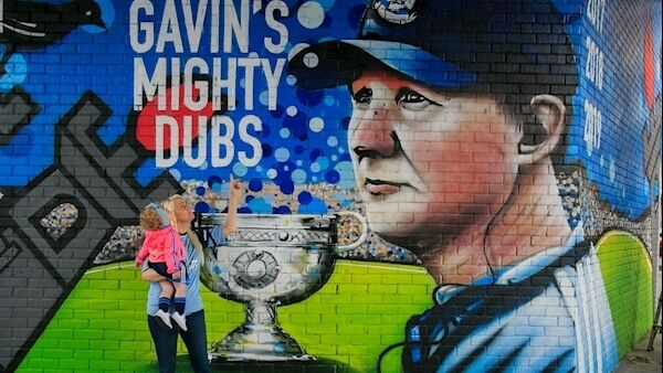Audrey Walker with 14-moth-old Erin from Ballybough at a Jim Gavin mural. Picture: Collins