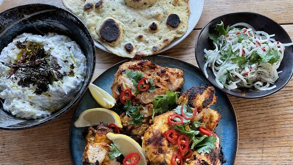 Tandoori chicken with flatbreads and courgette yoghurt