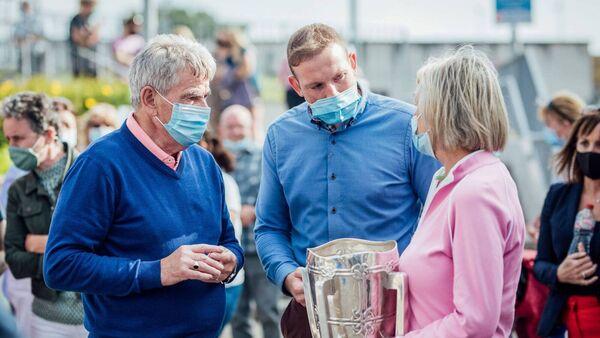 Limerick GAA fan celebrates surviving marathon Covid battle with Liam MacCarthy Cup - Irish Examiner