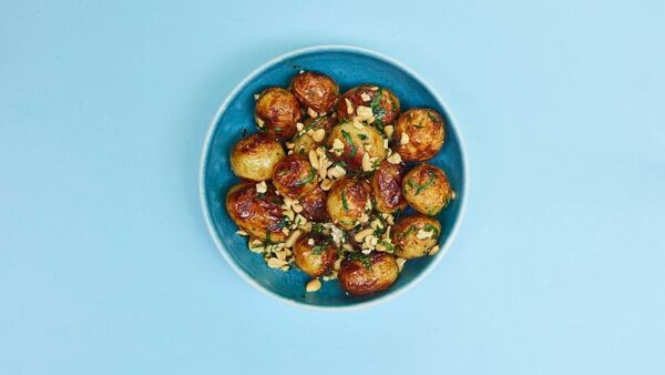 Simply barbecued new potatoes with tarragon, peanuts and chipotle