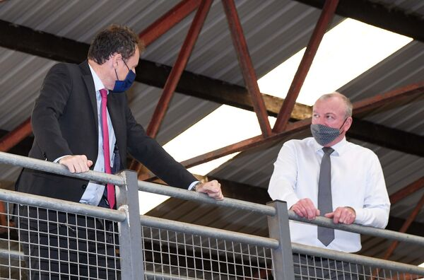 Charlie McConalogue (left) speaking to Sean O'Sullivan, CEO, Cork Marts, during his visit to Cahir Mart, Co. Tipperary.  Photo: Denis Minihane