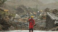 Mudslide rescuers battle elements and exhaustion