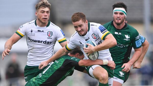 Paddy Jackson of London Irish is tackled by John Porch of Connacht during the pre-season friendly.  Photo: Piaras Mídheach / Sportsfile