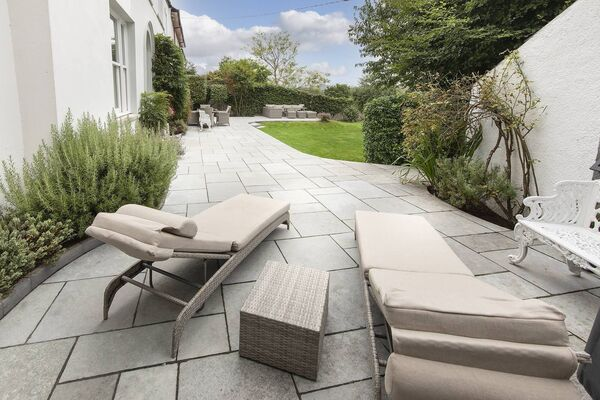 The Indian limestone terrace offers several seating areas