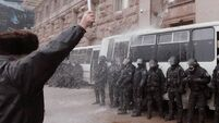 Ukraine riot police back down