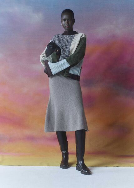 """Patchwork funnel neck sweater, € 179;  mesh skirt with flared detail, € 139;  """"Norah"""" patchwork shoulder bag, € 239;  Knee-highs 'Hadlow', Whistles, € 325."""