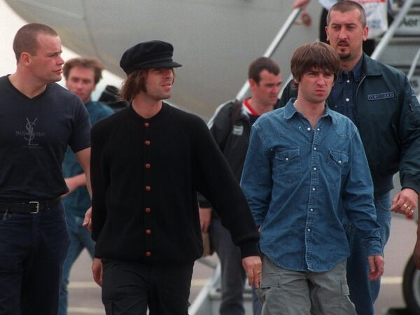Liam and Noel Gallagher of Oasis getting off the plane at Cork Airport with some of their entourage. Picture: Dan Linehan