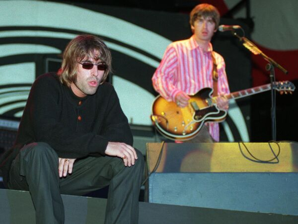 Liam and Noel Gallagher of Oasis on stage in Cork. Picture: Dan Linehan
