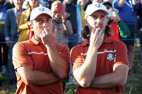 Team Europe's Francesco Molinari and Tommy Fleetwood watch the final action during the Foursomes match on day two of the Ryder Cup at Le Golf National, Saint-Quentin-en-Yvelines, Paris.