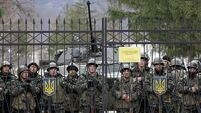 Fury as Russia tightens grip on Crimea
